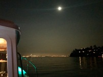 The moon hangs over the smoky San Francisco skyline.